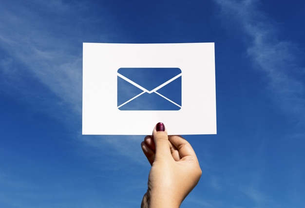 A hand holding email icon