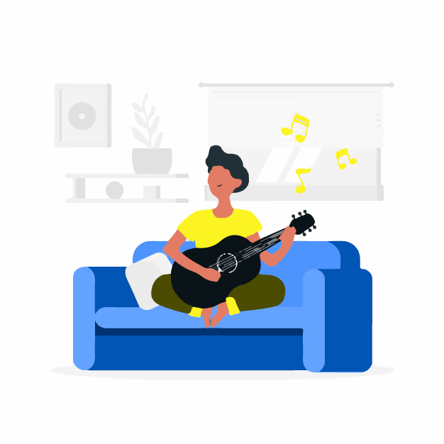 A man playing his guitar on a couch
