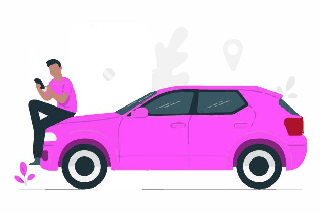 A man sitting on his car